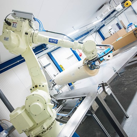 Robot arm processing wafer paper roll