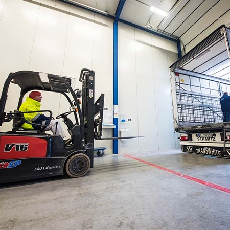 Employee loading truck with fork lift